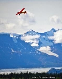 plane over mountains in alaska