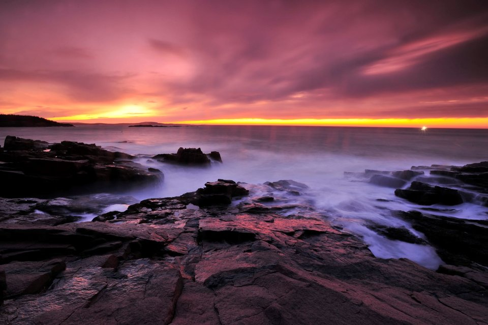 The surf surges through the rocks at Thunder Hole during daybreak. Raul Touzon/National Geographic Image Collection